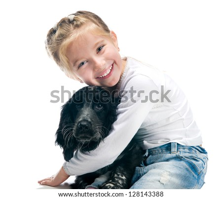 cute little girl with her puppy - stock photo
