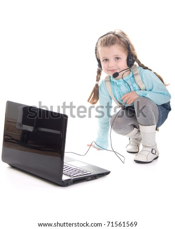 Cute little girl with laptop in headset smiling on white background - stock photo