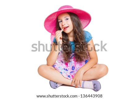 cute little girl with lipstick isolated on white - stock photo