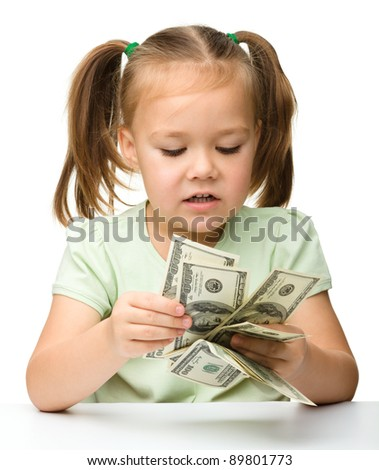 Cute little girl with paper money - dollars, isolated over white - stock photo