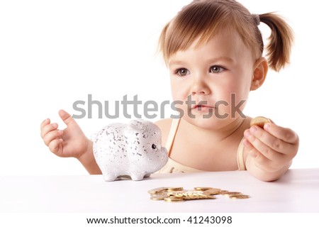 Cute little girl with piggybank, isolated over white - stock photo