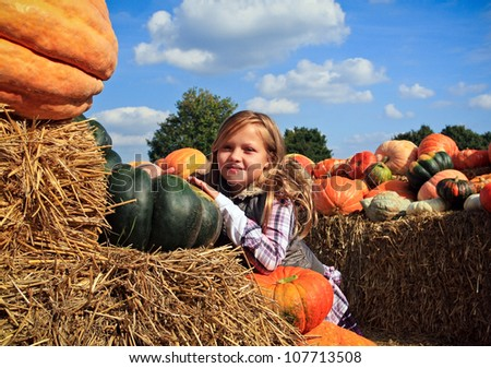 Cute little girls in a pumpkin patch