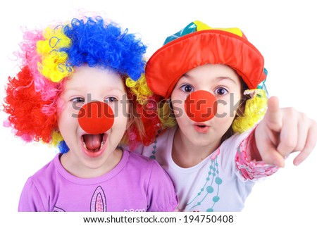cute little girls playing clowns  - stock photo