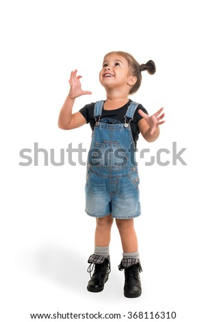 Cute little happy girl standing and looking up on  white background  - stock photo