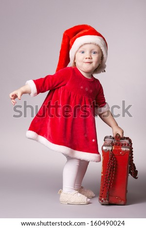 cute little happy girl with christmas suitcase - stock photo