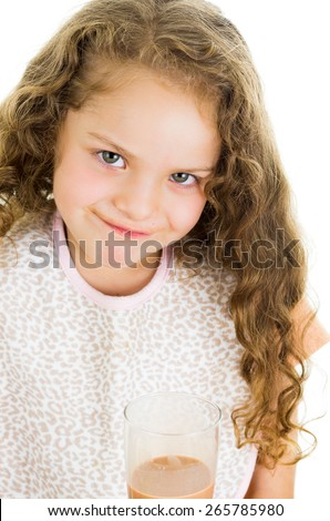 Cute little happy preschooler girl holding a glass of chocolate milk isolated on white - stock photo