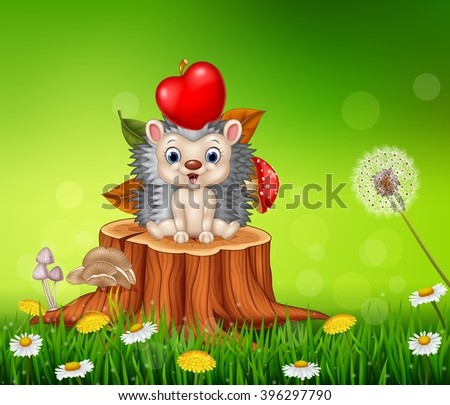 Cute little hedgehog sitting in the beautiful grass background - stock photo