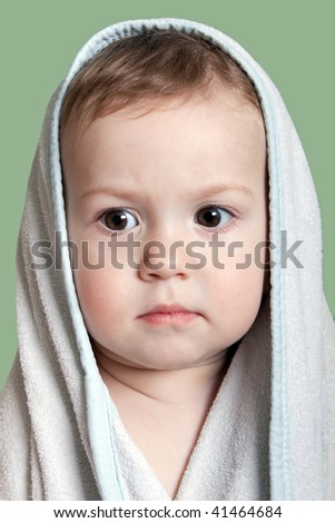 Cute little human baby child eyes on face in towel