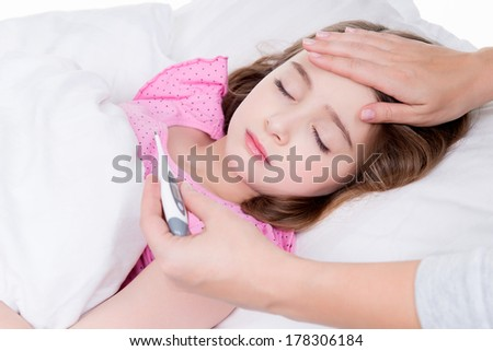 Cute little ill girl with a thermometer on a white background. - stock photo