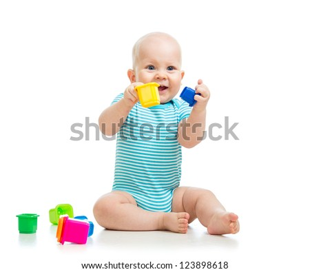 Cute little kid is playing with toys isolated over white - stock photo