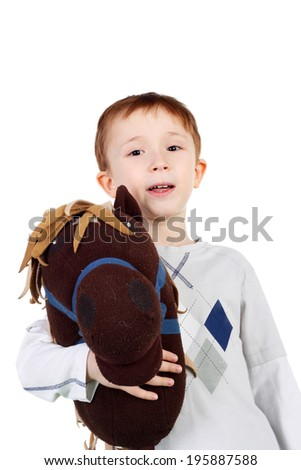 cute little kid with the plush toy horse - stock photo