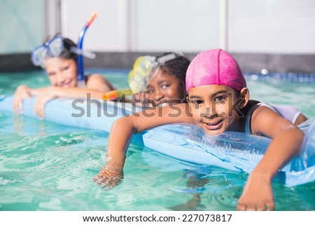 Cute little kids swimming in the pool at the leisure center