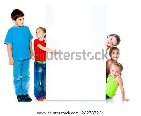 cute little kids with happy faces near the white banner - stock photo