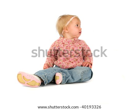 Cute little one year old girl in pink sweater and blue jeans isolated on white - stock photo
