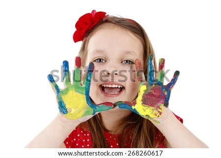Cute little painter with dirty hands - isolated studio portrait