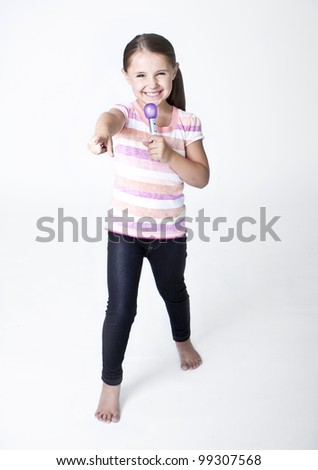 Cute little Pop Star singing on white background - stock photo