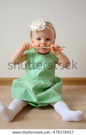 Cute little princess in green dress