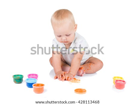 Cute little redhead girl painting with brush. Isolated on white background
