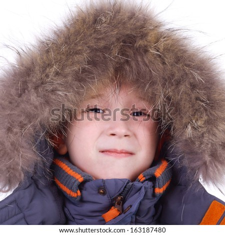 cute little smiling child in the winter fur clothing - stock photo