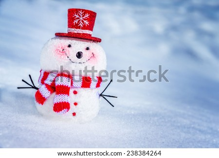 Cute little snowman standing in the snow outdoors, funny winter symbol, beautiful Christmas greeting card - stock photo
