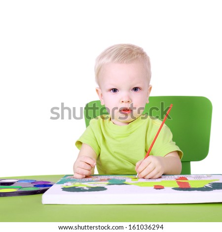cute little talented boy painting