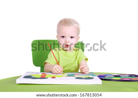 cute little talented boy painting - stock photo