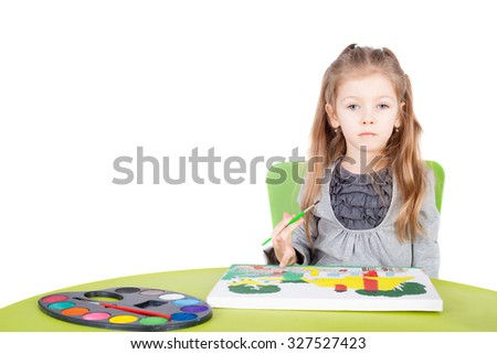 cute little talented girl painting