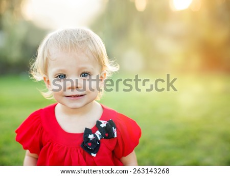 Cute little toddler in the glowing sun - stock photo