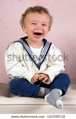 Cute little victorian toddler boy dressed in vintage sailor costume - stock photo