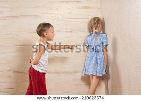 Cute Little White Kids Playing at Home While Parents Not Around. - stock photo