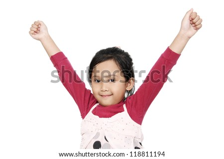 Cute little years girl raises her hands in a victory sign isolated