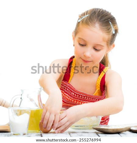 cute llittle girl cooking isolated on a white background - stock photo