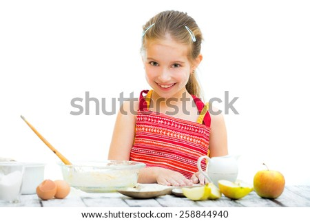 cute llittle girl cooking, on a white background - stock photo