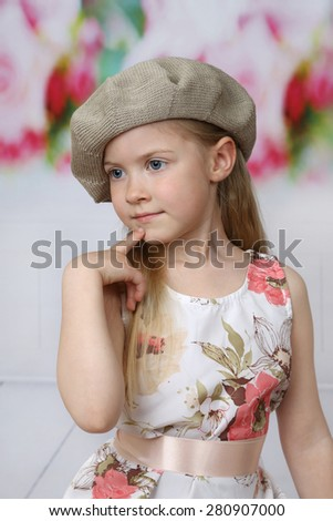 Cute long haired girl in beret portrait - children beauty and fashion concept - stock photo