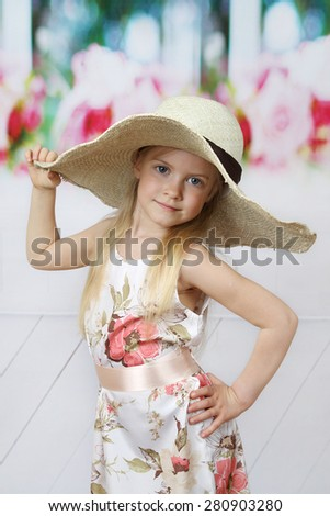 Cute long haired girl in big hat portrait - children beauty and fashion concept - stock photo