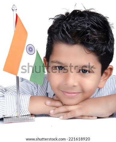 Cute looking indian kid with indian flag - stock photo