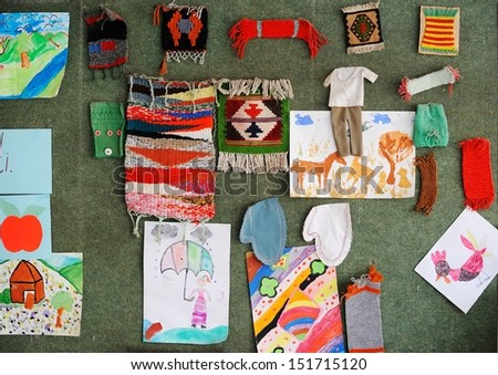 Cute lovely school children at clasroom having education activities making artistic craft - stock photo