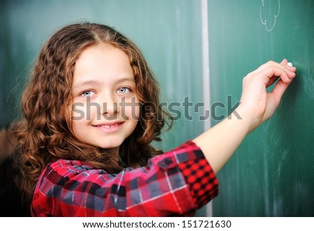 Cute lovely school children at classroom having education activities - stock photo