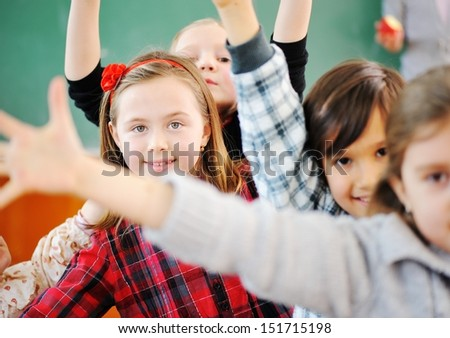Cute lovely school group of children at clasroom having education activities - stock photo
