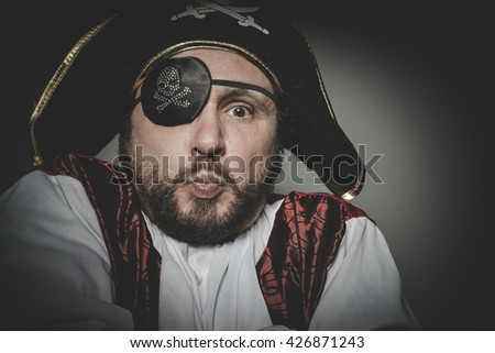 Cute, man pirate with eye patch and old hat with funny faces and expressive
