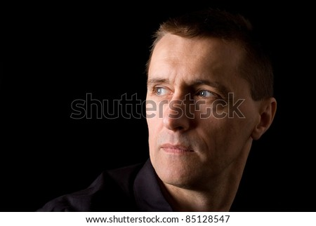 cute man posing on a black background