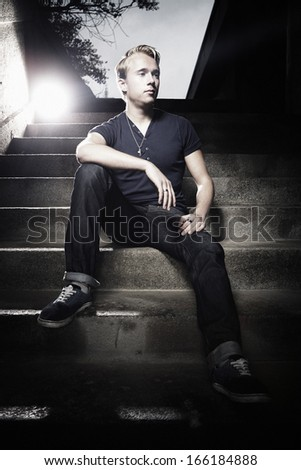 Cute man posing on stairs