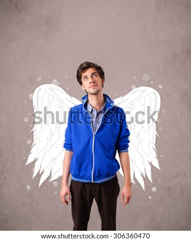 Cute man with angel illustrated wings on grungy background - stock photo