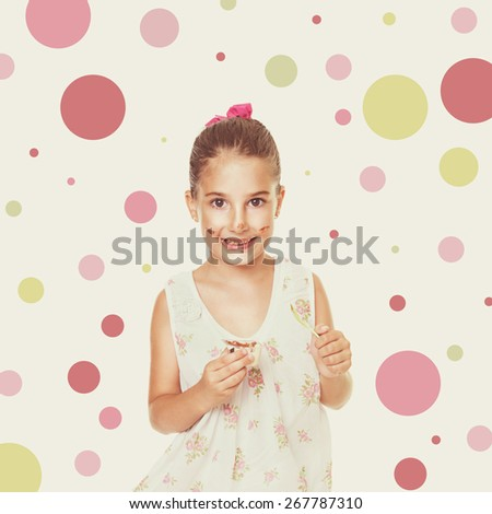 Cute messy little Caucasian girl in floral dress eating cocoa cream smiling looking at camera. Pastel filter and dots in the background, retouched, square format image. - stock photo