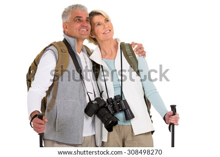 cute mid age hiking couple looking up on white background - stock photo