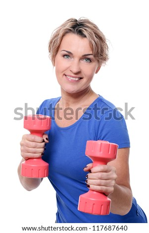 Cute mid aged women do exercises with dumbbells isolated on a white - stock photo