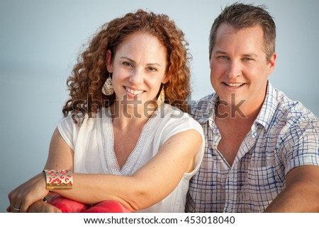 Cute middle aged couple head and shoulders outdoor portrait - stock photo