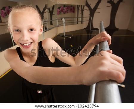 Cute mixed race ballerina in dance studio - stock photo