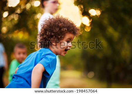 Cute mixed race boy, in park - stock photo