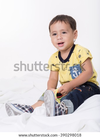 Cute Mixed Race boy on a white background